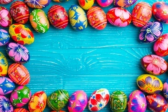 blue-wooden-surface-with-easter-eggs-frame_23-2147601979